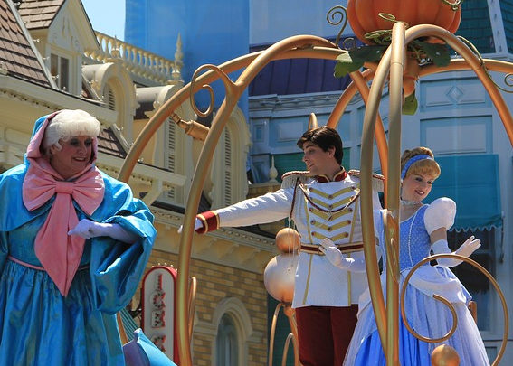 The Fairy Godmother, Prince Charming, and Cinderella on Parade
